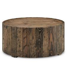 from rc willey this natural wood grain round coffee table from the dawson collection will make for a wonderful new addition to your living room the
