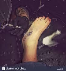 Tattoo On Foot Immagini Tattoo On Foot Fotos Stock Alamy