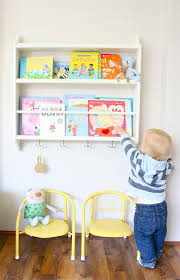 Plate Rack: A bookshelf can make it hard for little fingers to find each  book. Put them on display in an IKEA plate rack so they know which book to  reach ...