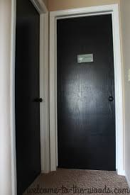black interior doors and white trim casing around door transform your home by painting the
