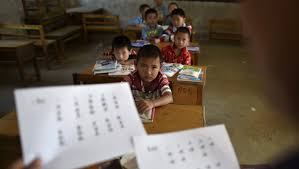 a chinese fourth grader s heartbreaking essay to her abusive  students look at their teacher holding papers of the new curriculum at a classroom of dalu