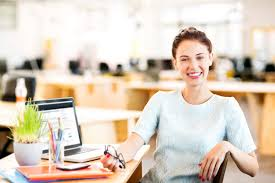 Employee Office Happy Entrepreneur Sitting At Office Desk The Engage Blog