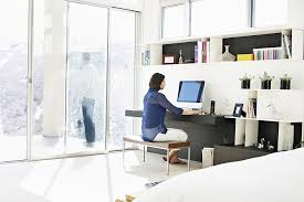 home office on a budget. Woman Sitting At Desk In Bedroom Working On Computer Husband Background Standing Deck Looking Home Office A Budget E