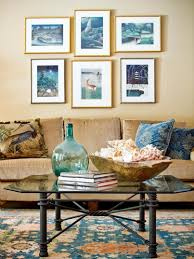 living with add book. living room blue cushion sofa painting glass coffee table book vase carpet how to add with