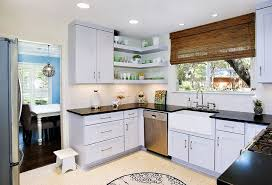 View in gallery Chic modern kitchen with cool corner floating shelves [ Design: UB Kitchens]