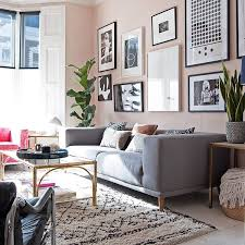contemporary living room with grey sofa blush walls and beni ourain style rug wall