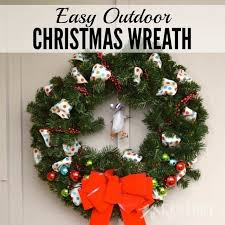 Love this idea to decorate an outdoor Christmas wreath with ribbon, beads  and ornaments.