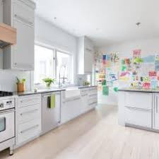 white cabinets light floors. bright, updated kitchen with light wash floors white cabinets e