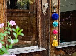 to enlarge image diy pom pom doorknob garland jpg