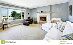 White Sofa Living Room Light Blue Living Room With White Sofa And Fireplace Stock Photo