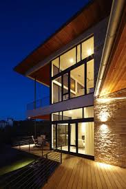 modern exterior lighting. wood overhangs always look great as exterior lighting spills out modern