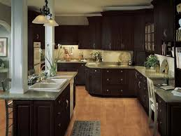 classic modular oak kitchen cabinet with granite countertop and kitchen bar table under black iron 2 lights pendant lamp