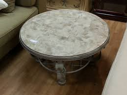 terrific round marble top coffee table of fascinating design with grey metal base and