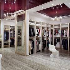 Two Storey Walk-In Closet With Chandelier.