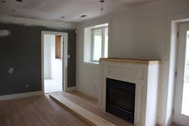 we installed the faux wood laminate flooring and had that grey wall painted when we moved in the latter will be the site of the