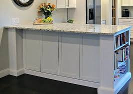kitchen islands with cabinets kitchen peninsula in white cabinets with bookcase end decorative door panels on