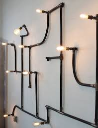 diy pipe lighting. wall or ceiling repurposed pipe light installation industrial decor lighting diy