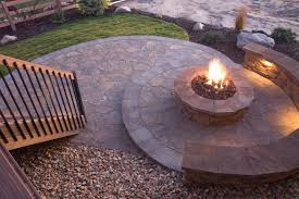 radial flagstone patio with fire pit in the center