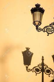 mediterranean lighting. Cast Irons Street Light Casting A Shadow On Mediterranean Old Town House Facade Stock Photo Lighting