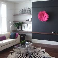 Black feature wall looks great with pink African headress.
