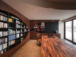 interiorenchating home library decor with built in book shelves and black leather sofa over built home library
