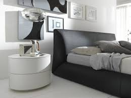round modern unique nightstands under silver pendant lamp framed pictures and black upholstery bedroom brown with