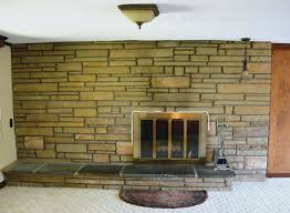 tiling over painted brick fireplace surround fireplce pinted white with black insert dark walls