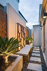 Side Yard With Pathway And Metal Wall Art