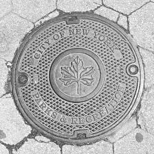 the well trodden art of the manhole cover in new york city a con edison manhole cover a manhole cover for the new york city department of parks recreation