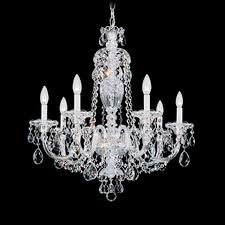 sterling exemplifies the eighteenth century style all crystal chandelier with hand formed crystal arms and elaborately cut crystal pendants column pieces