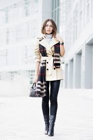 lydia lise millen looks ultra chic in this belted cream trench worn with a statement
