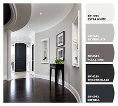 light gray walls, white trim, dark floors in this stunning foyer.+ molding  and curved walls. my colors for sure!