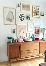 mid century wall decor love this gallery wall with cool colorid century furniture this is so pretty mid century starburst wall decor