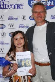 Young author Nadine Foreman holding her book Editorial Stock Photo ...