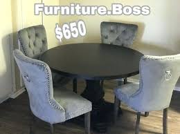 round table moreno valley round dining table 4 grey velvet chairs valley table als in moreno