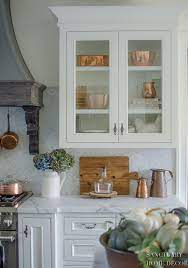 how to style glass kitchen cabinets