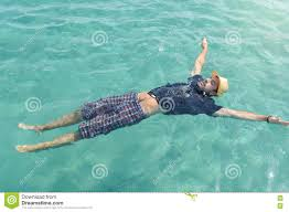 man floating on the water. Summer relaxation