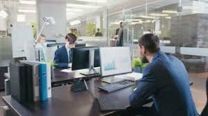 Office desk tops Items Diverse Team Of Businessmen And Businesswoman Working At Their Desktops In The Modern Office They Have Discussions Work With Papers And Do Business Video Blocks Diverse Team Of Businessmen And Businesswoman Working At Their