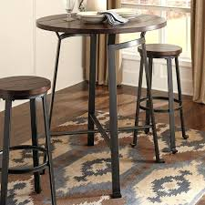 s small round pub table with stools