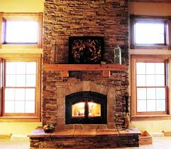 cedar fireplace mantel with an abstract painting a gas fireplace building with bricks material construction