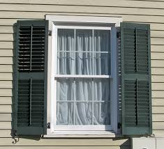 exterior wood storm shutters. green wood louvered window shutters exterior storm