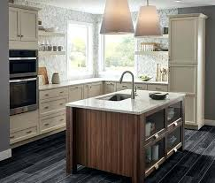 light granite countertop white kitchen cabinets with