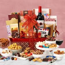 a grand gift with a big red bow the recipient for this gift basket would get to e