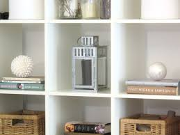 Small Picture white wooden Wall Shelving Unit with some racks and brown storages