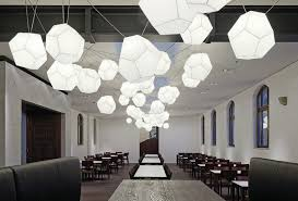 sculptural lighting. custom pendants create a sculptural lighting element in the old guardhouse which is now l