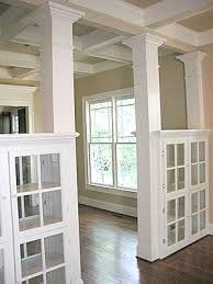 formal dining rooms with columns. love the see through glass cabinets used to separate 2 areas of your home - living room/dining room divider? formal dining rooms with columns u