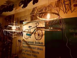 making chandeliers out of old bike parts at the access bike work