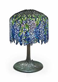 tiffany studios a wisteria leaded glass and bronze table lamp circa 1905 26½ in 68 cm high 18 in 45 8 cm diameter of shade