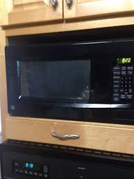 ge 1 4 cu ft countertop microwave oven white 1100 watts com