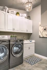 laundry room cabinets laundry room traditional with gray floor tile gray area rug